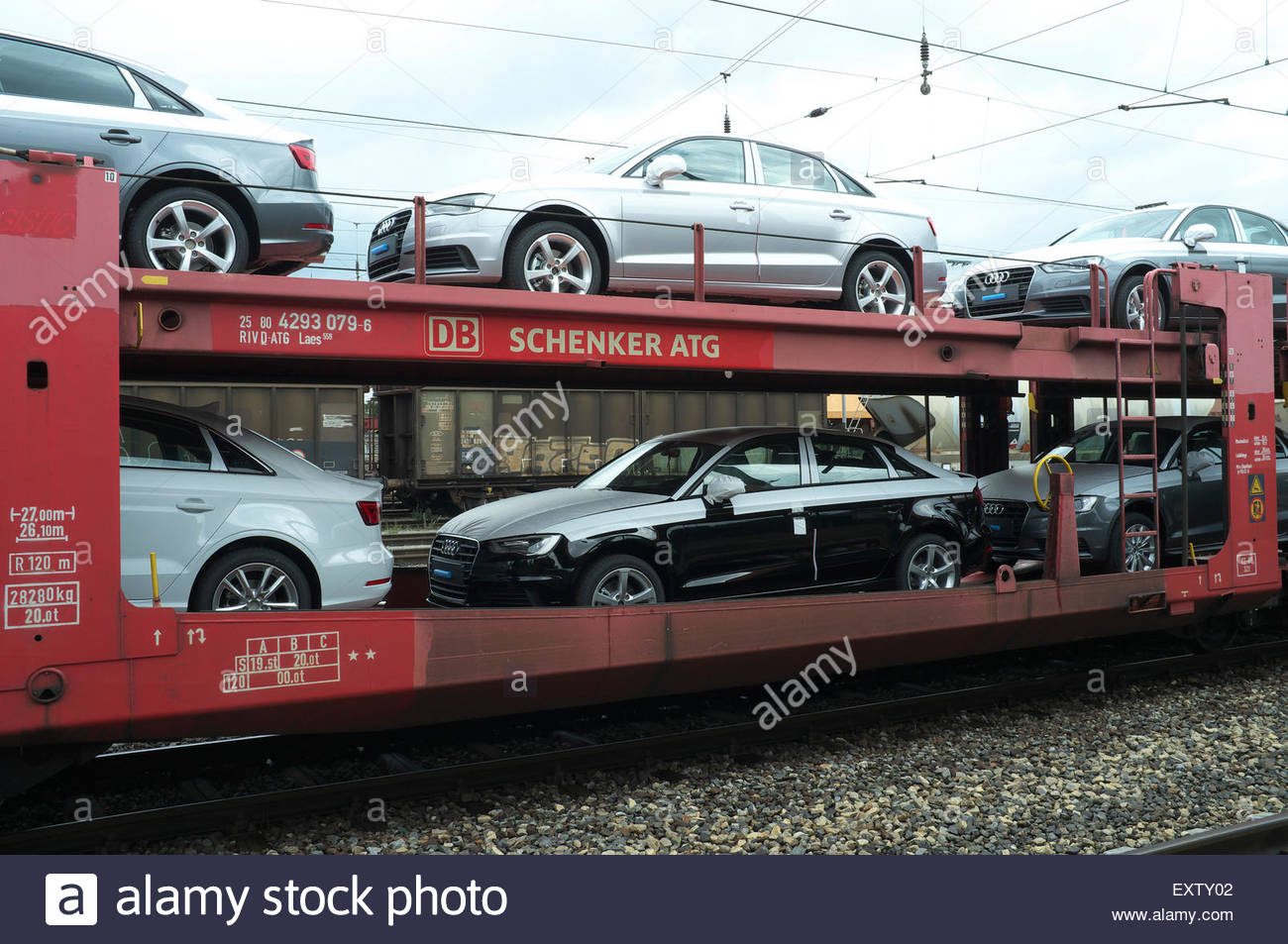 New Audi Motor Cars On Rail Freight Wagons In A Goods Yard In Stock