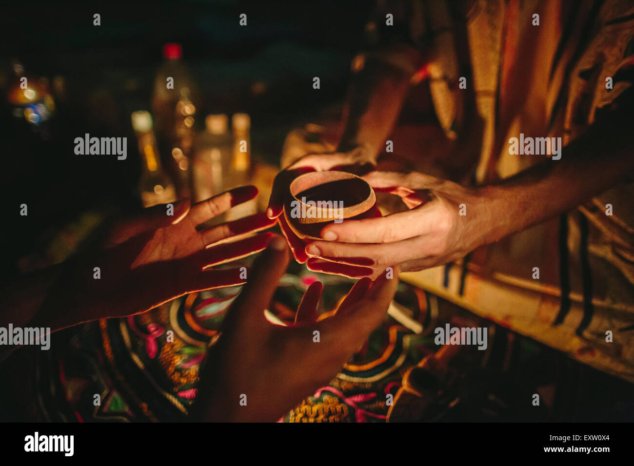 A man receives a cup of Ayahuasca, a traditional Shipibo Amazonian plant medicine used to for visionary healing Stock Photo