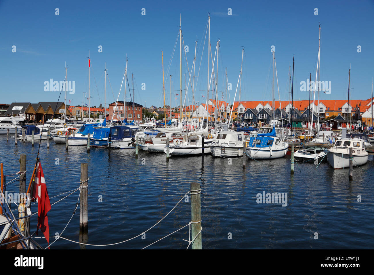 The marina in Hundested Harbour, North Sealand, Denmark, on a sunny summer's day with a blue sky - Stock Image