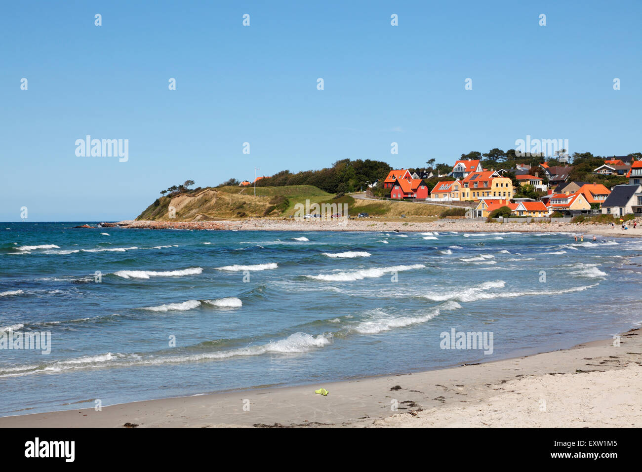Surf at Hundested Beach on a summer's day, to the left the lower part of the 30m cliff, Spodsbjerg, also housing - Stock Image