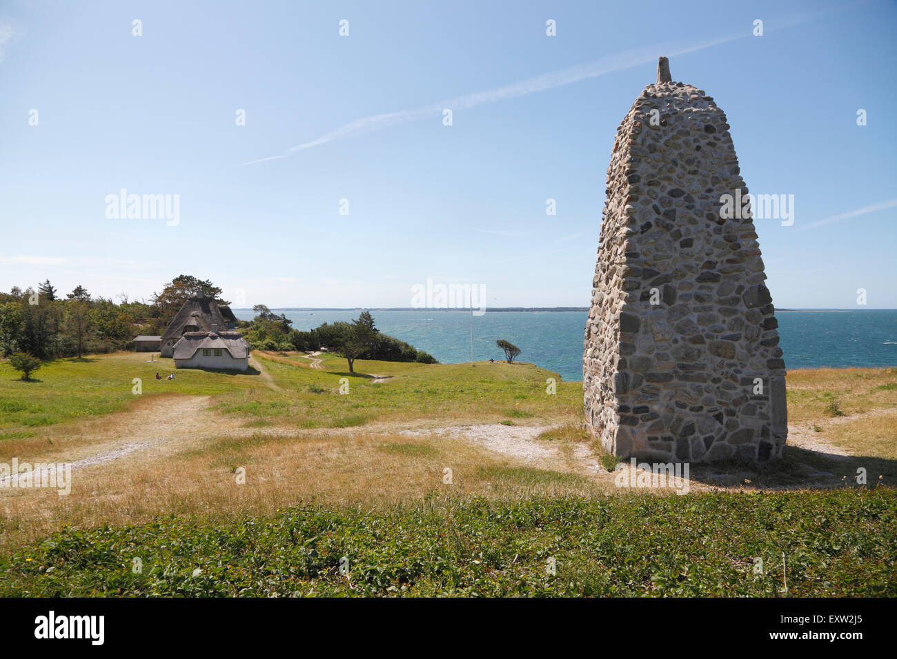 The memorial rock cairn and Knud Rasmussen's house on the cliff Spodsbjerg at Hundested, North Sealand, Denmark. Stock Photo