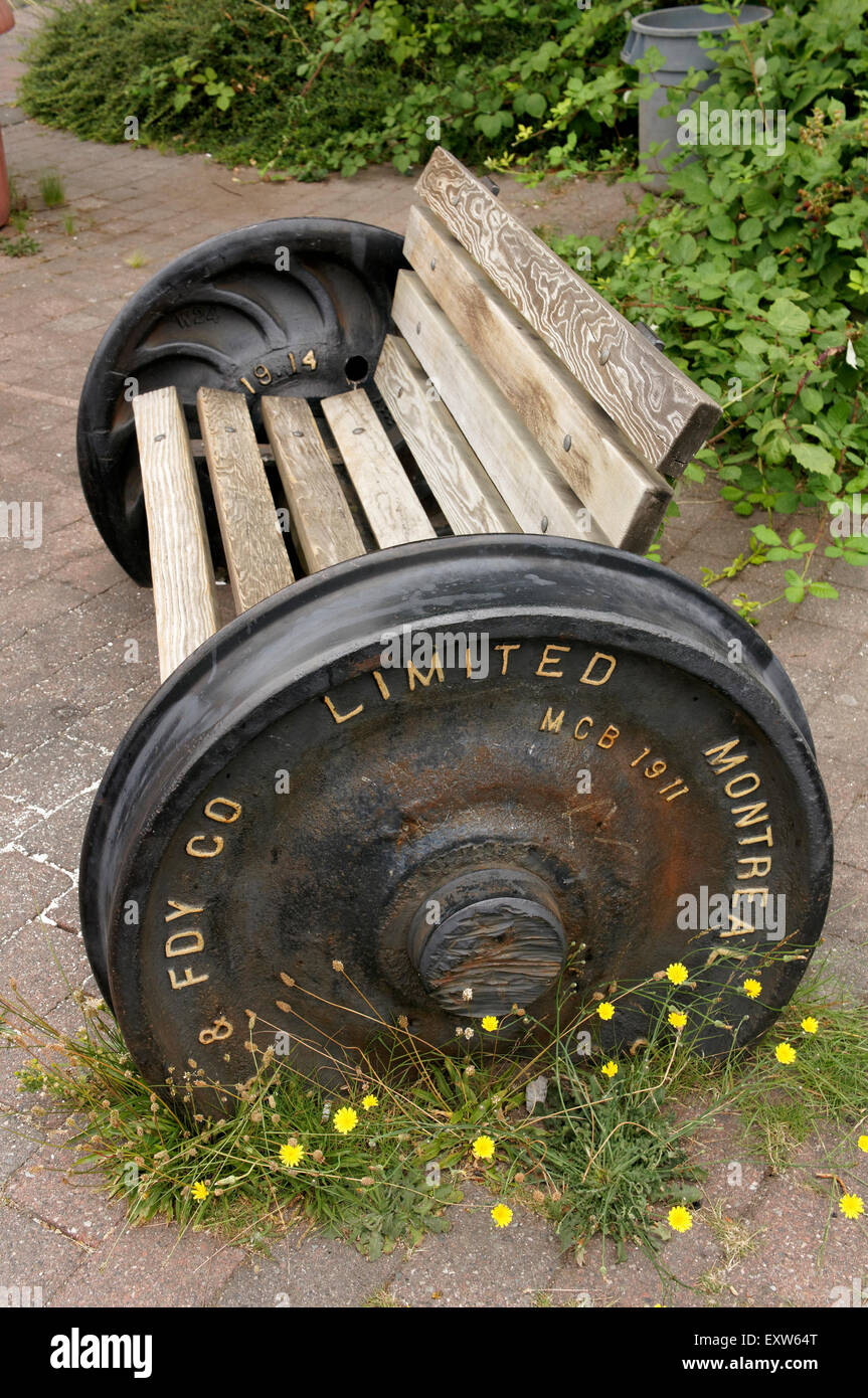 Old train wheels upcycled into a public bench, Kerrisdale Village, Vancouver, BC, Canada - Stock Image