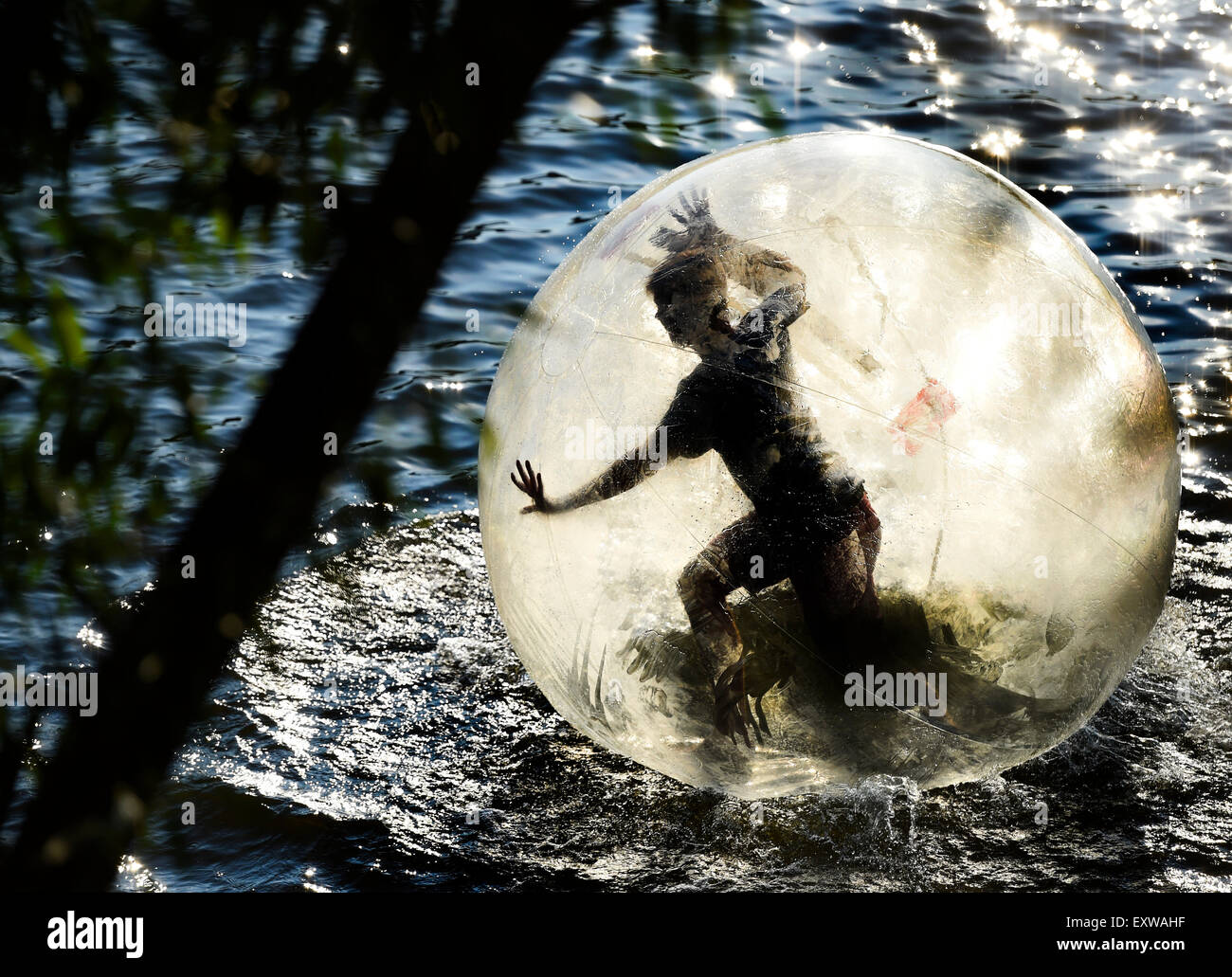 Prague, Czech Republic. 16th July, 2015. Zorbing, summer atraction at the Vltava river in Prague, Czech Republic, Stock Photo