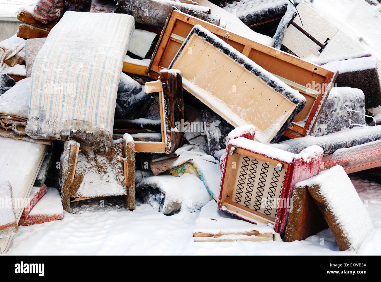old furniture for disposal under the snow - Stock Image