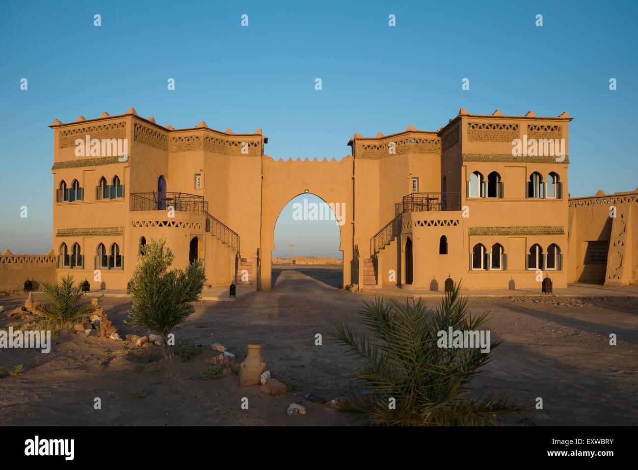 Kasbah style hotel, clay construction, Merzouga, Meknès-Tafilalet Region, Morocco Stock Photo