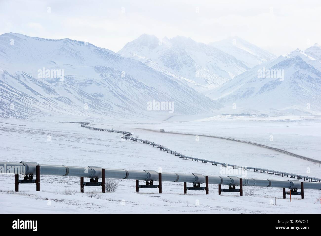 Oil pipeline from Prudhoe Bay to Valdez in the Arctic winter along the Dalton Highway, Haul Road, Alaska, USA - Stock Image