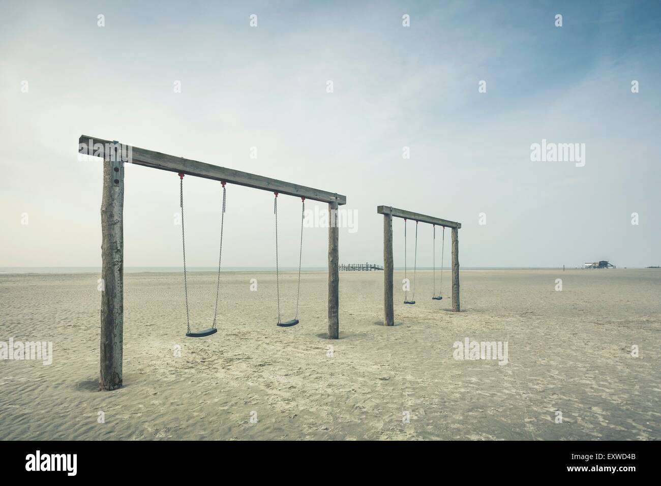 Empty swings on the beach of Sankt Peter-Ording, Schleswig-Holstein, Germany - Stock Image