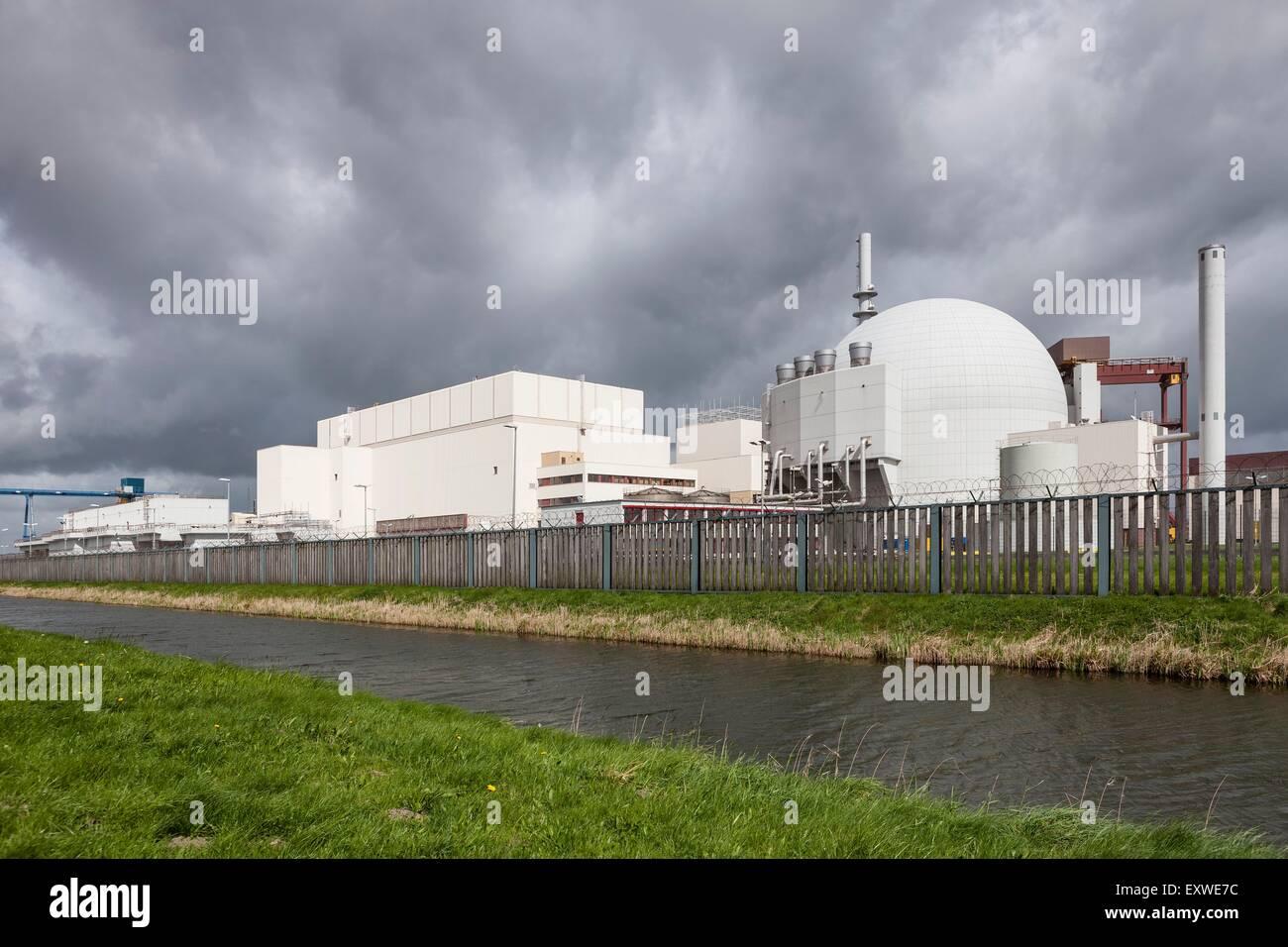 Dark clouds over Brokdorf nuclear power station, Schleswig-Holstein, Germany - Stock Image