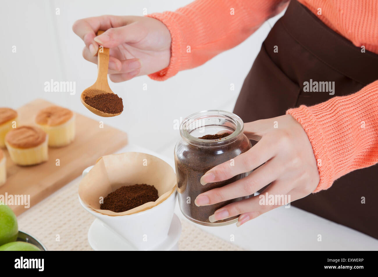 Young woman making coffee in the kitchen, - Stock Image