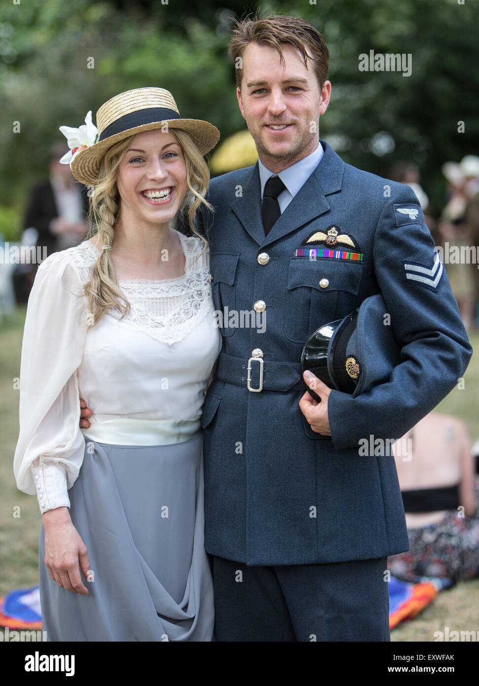 Picnic in the square with man in RAF uniform and Lady with boater - Stock Image