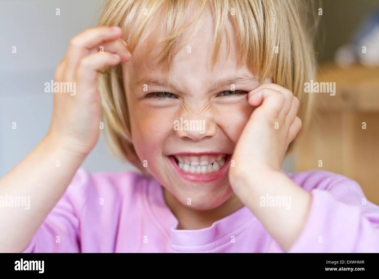 Girl pulling faces - Stock Image
