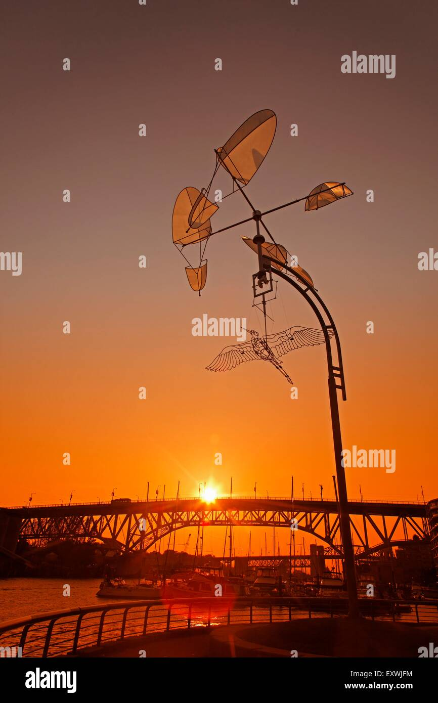 Sunset at False Creek with work of art, Vancouver City, Canada - Stock Image