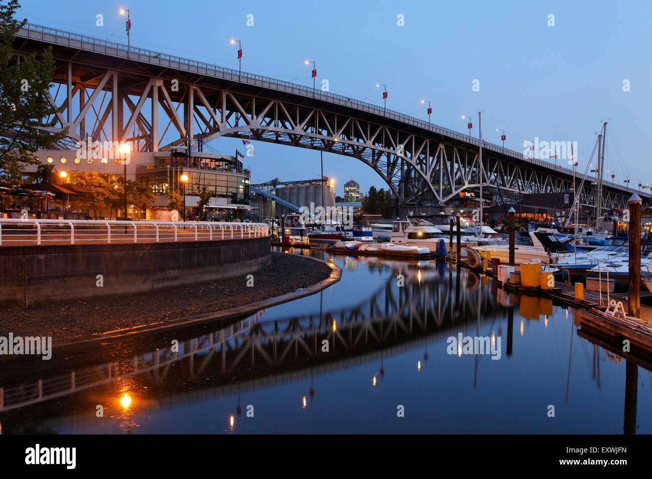 Promande and small Marina at False Creek at twilight, Vancouver, Canada - Stock Image