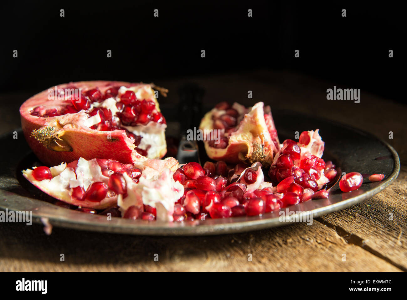 Moody natrual lighting images of fresh juicy pomegranate with vintage style Stock Photo