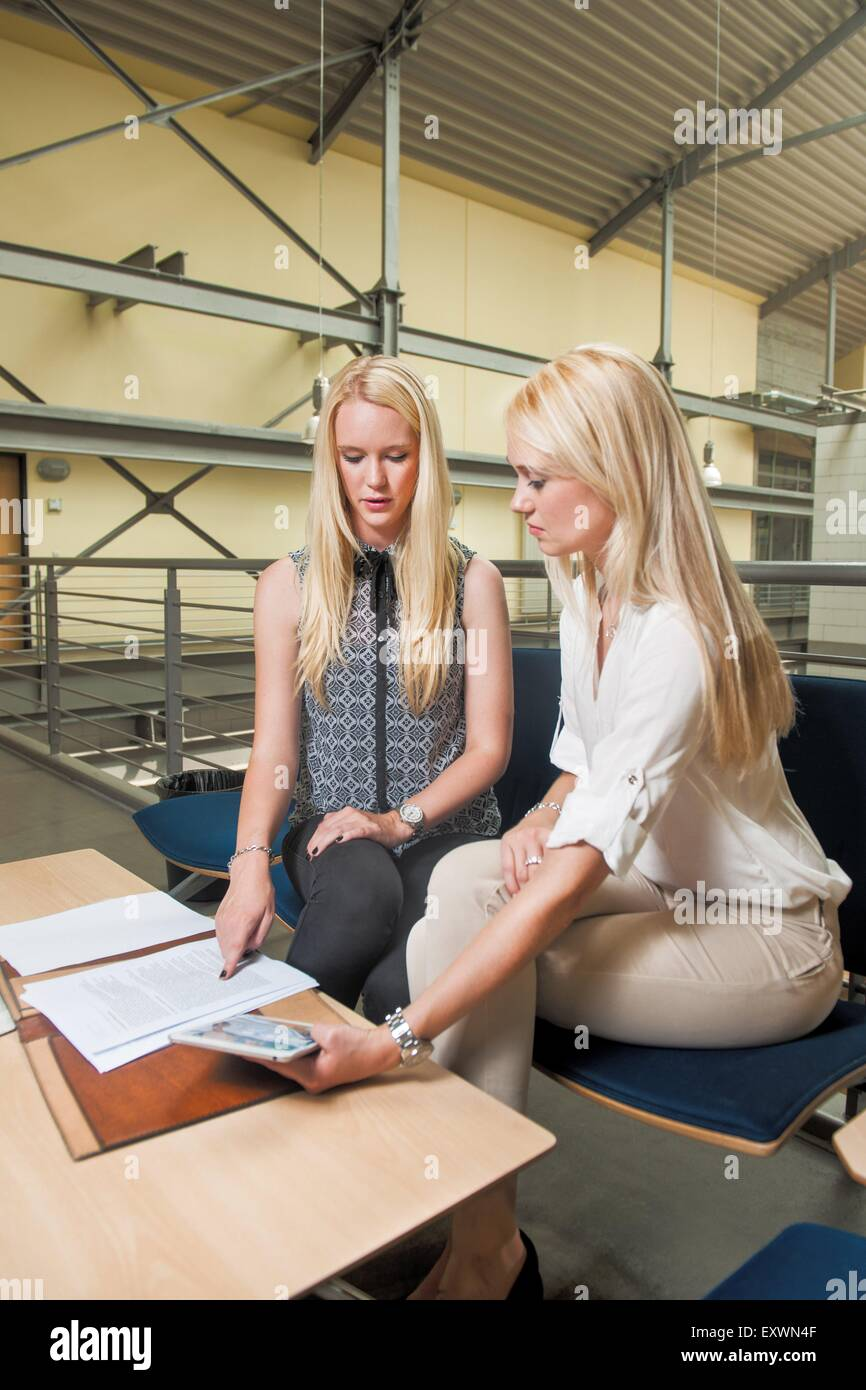 Two blond young women in office - Stock Image