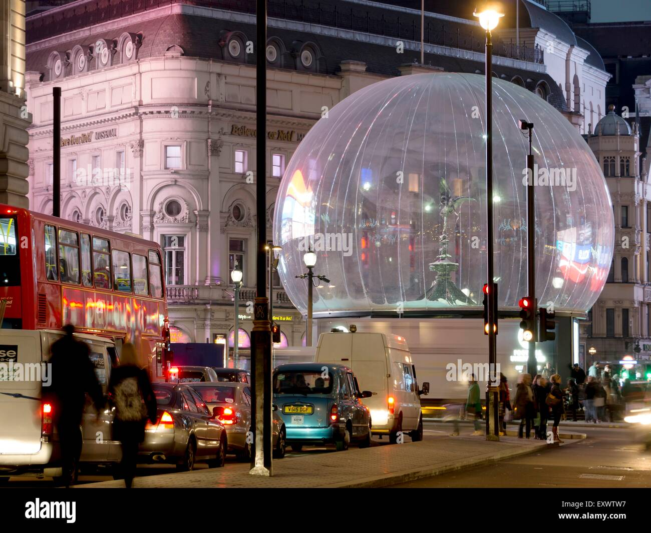 Eros statue at Piccadilly Circus in transparent ball, London, England, UK - Stock Image