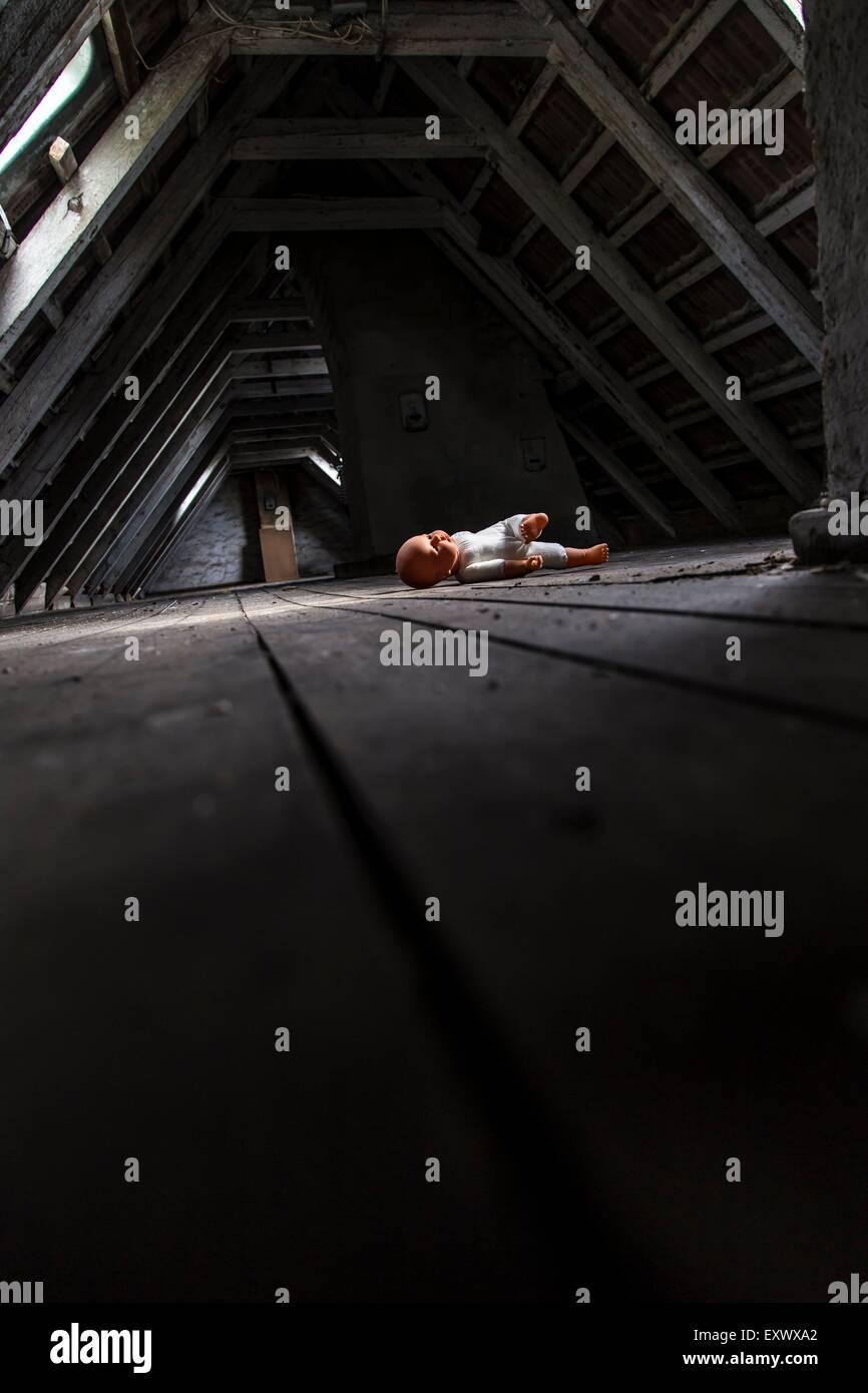 Doll on an attic, Kiel, Schleswig-Holstein, Germany, Europe - Stock Image