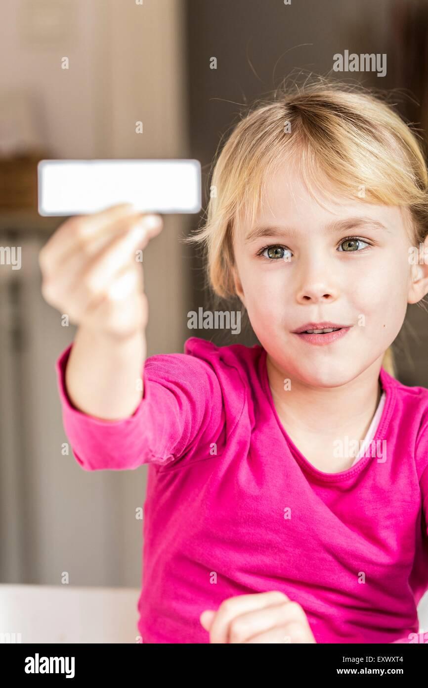 Blond girl holding aloft a white sign, Kiel, Schleswig-Holstein, Germany, Europe - Stock Image