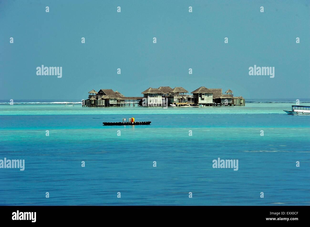 Stilt huts in indian ocean, The Maledives - Stock Image