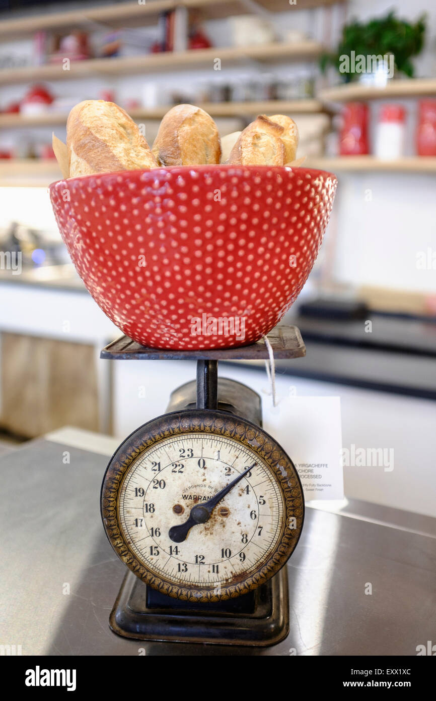 Close-up of red bowl on scale - Stock Image