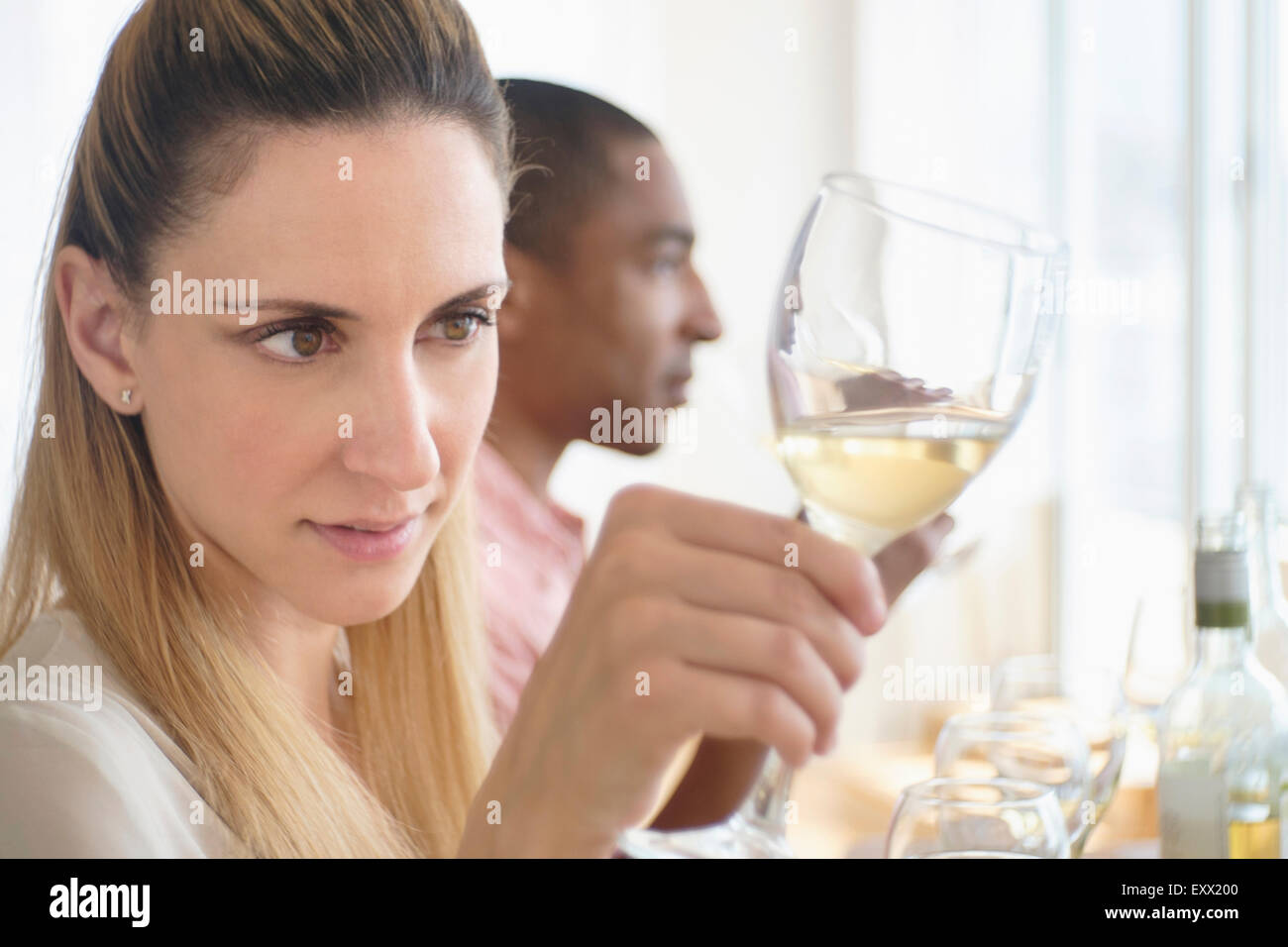 Man and woman tasting white wine Stock Photo