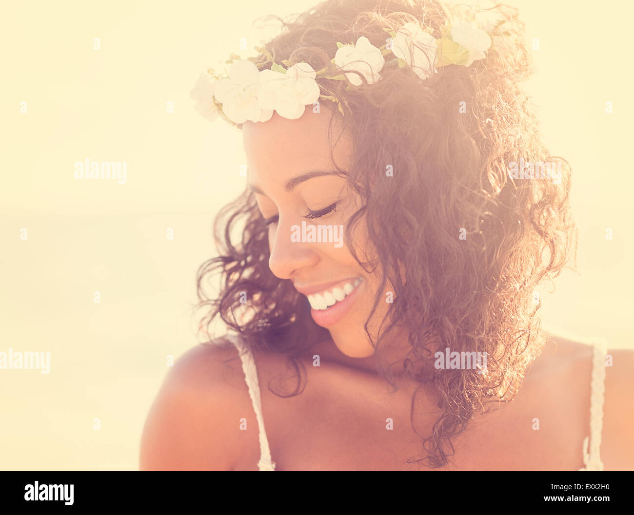 Young woman wearing wreath - Stock Image