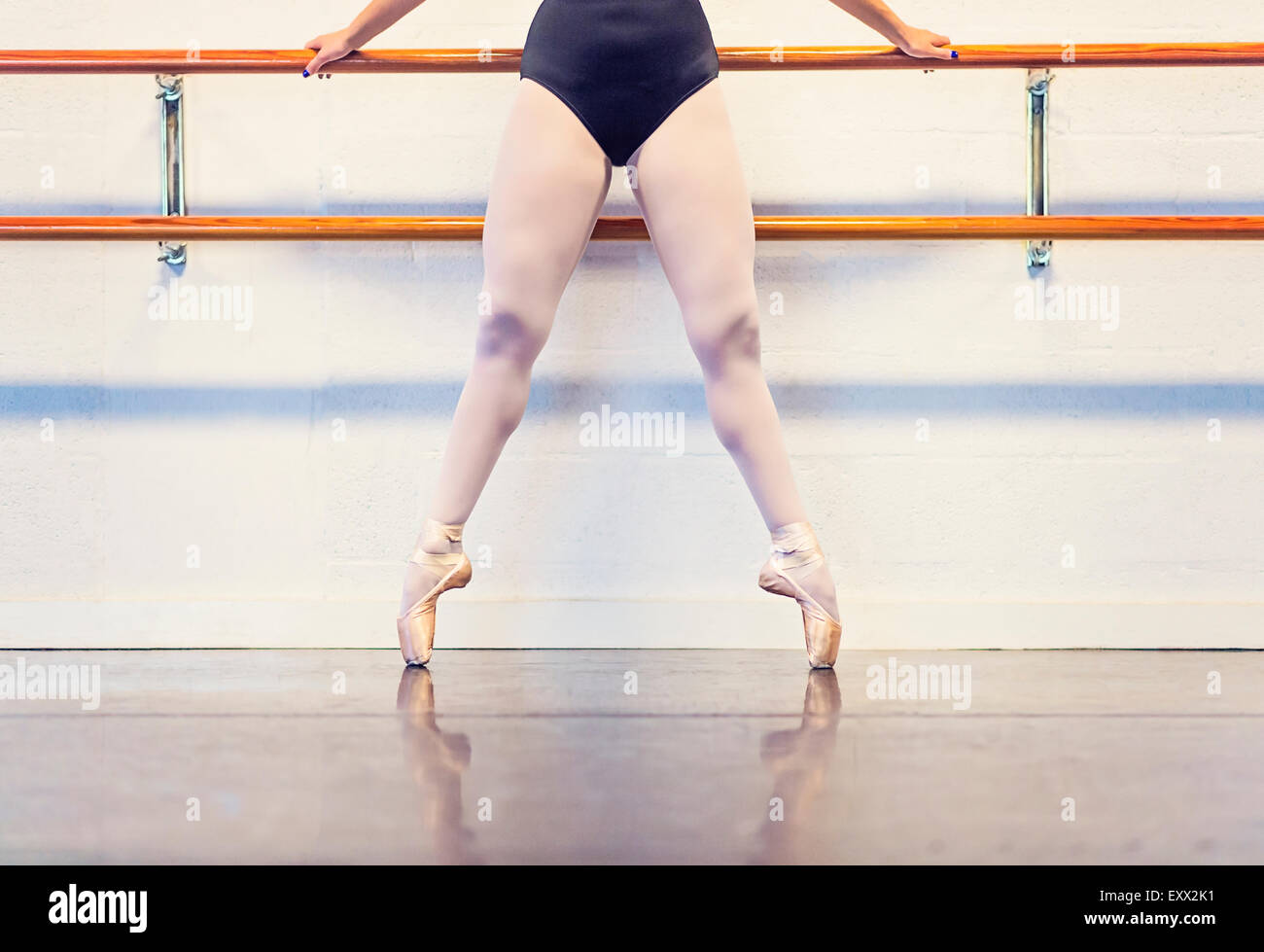 Young woman dancing in dance studio - Stock Image