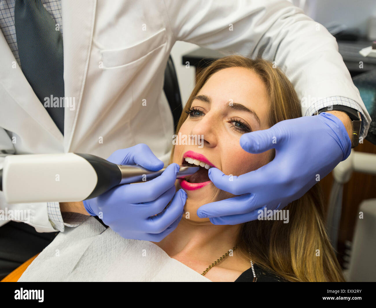 Dentist and patient in dentist's office - Stock Image
