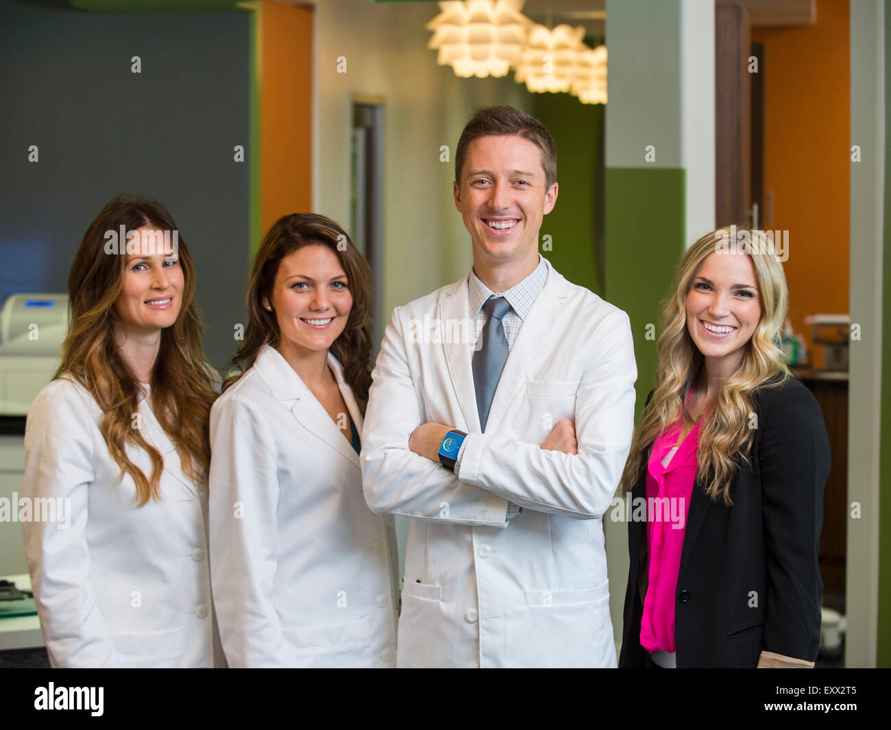 Portrait of dentists and patient - Stock Image