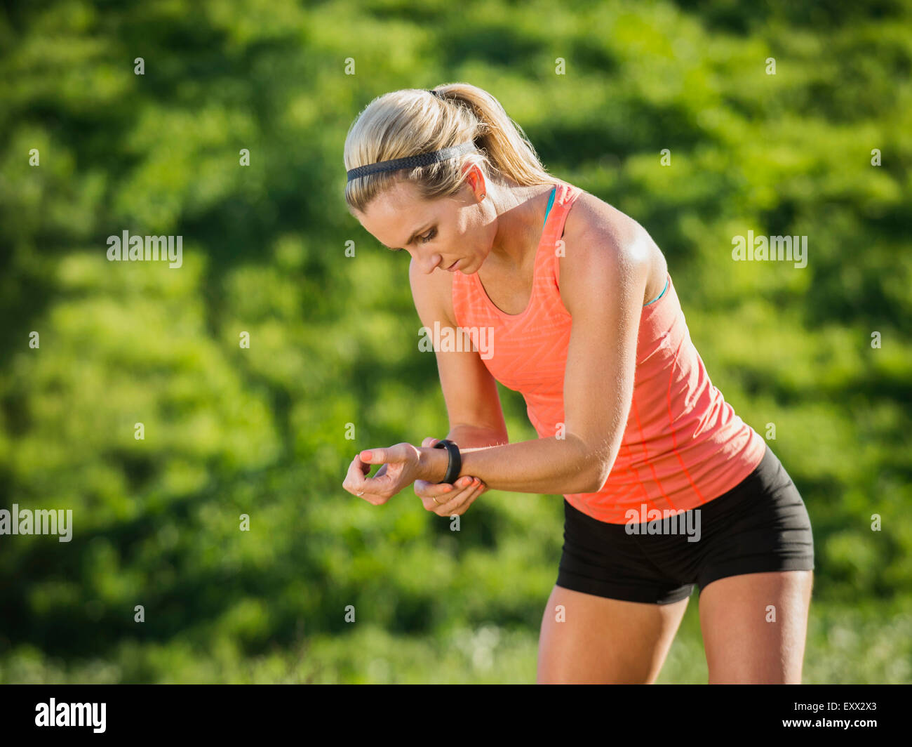Woman looking at watch - Stock Image
