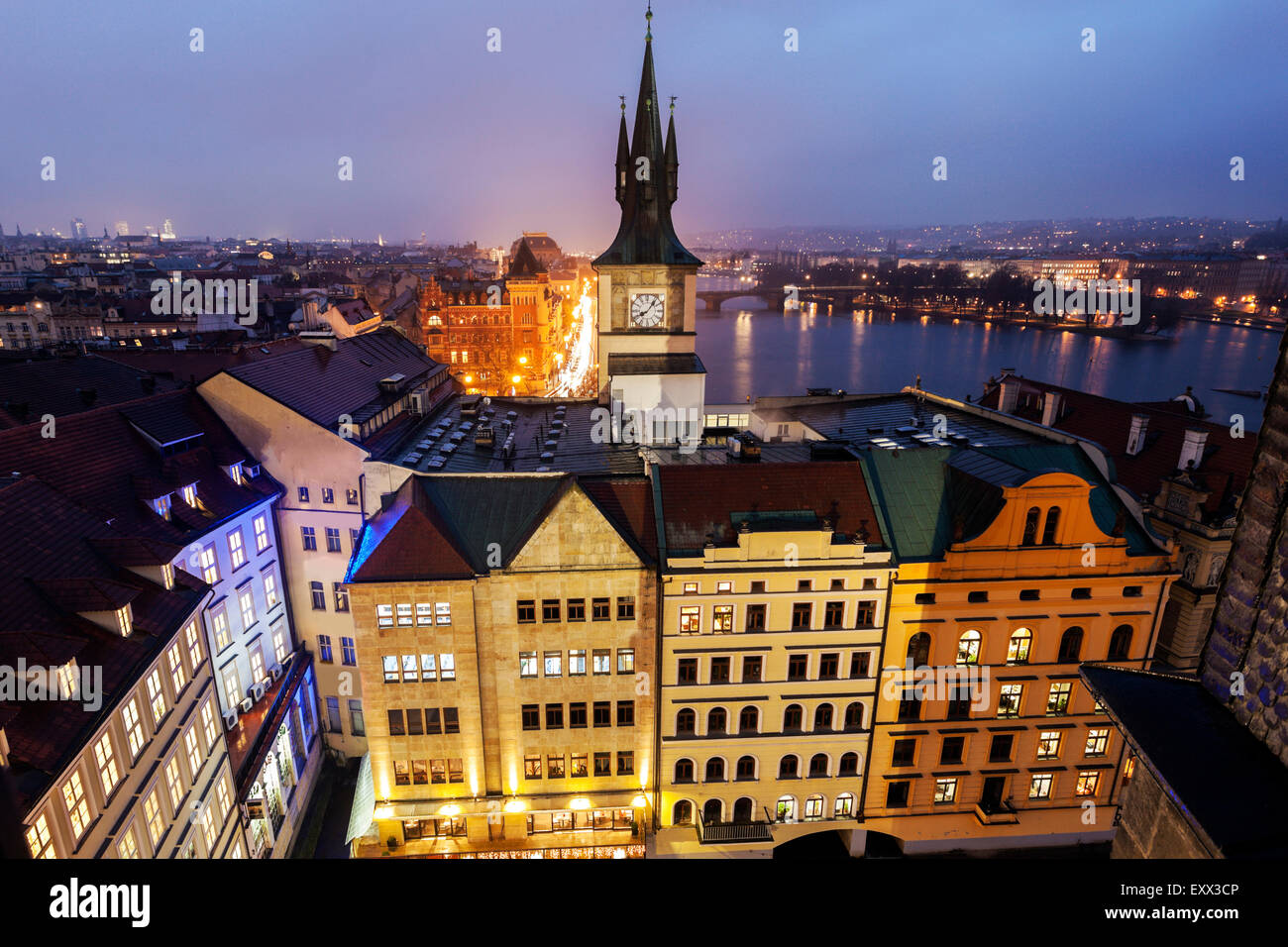 Old town tower by Vltava River at sunset - Stock Image
