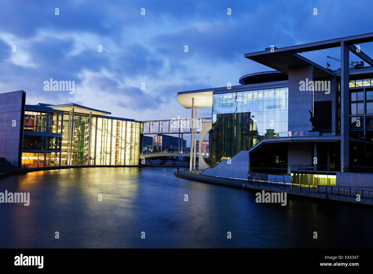 Federal Parliament offices illuminated at dusk - Stock Image
