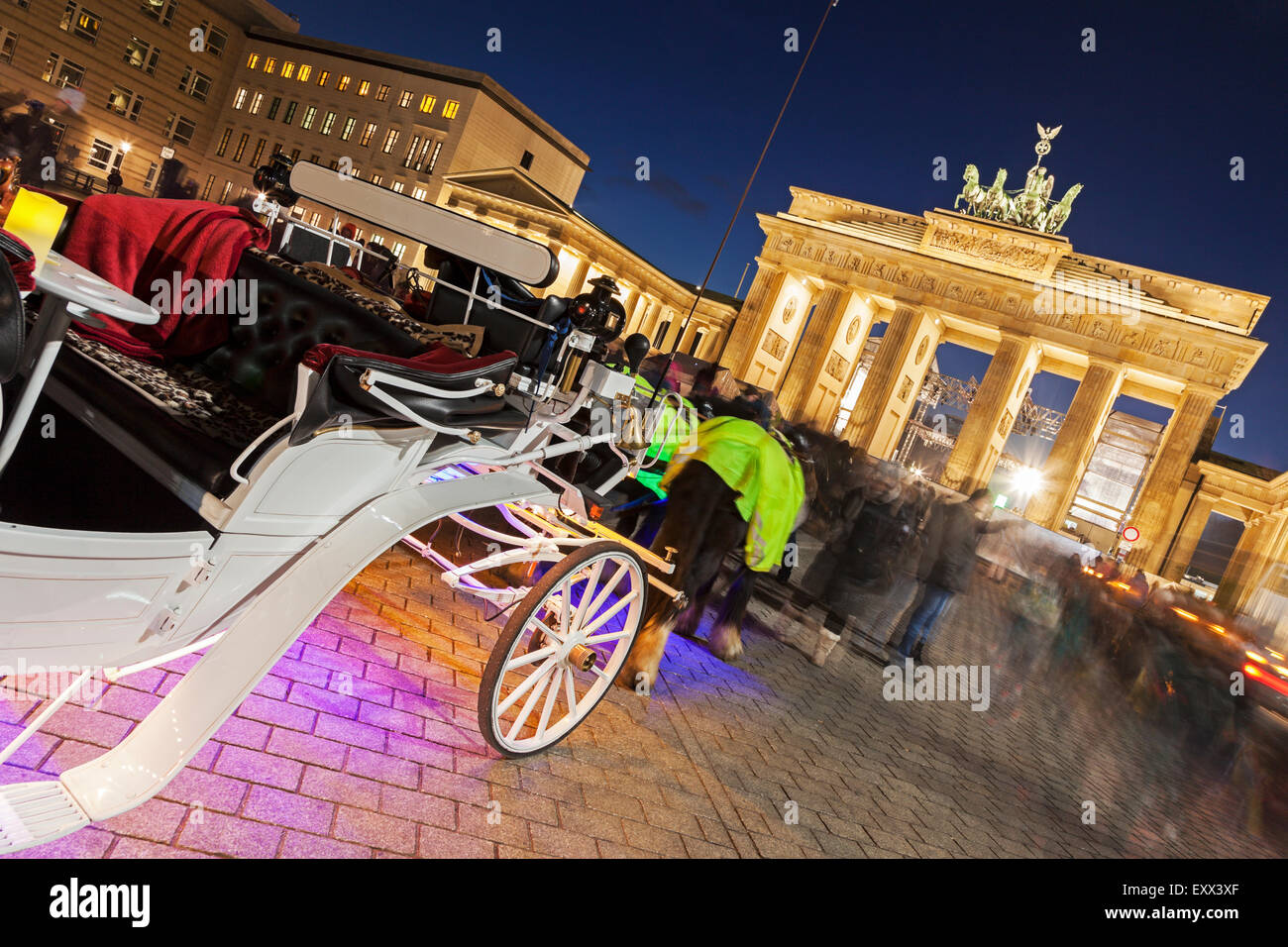 Horse carts in front of illuminated Brandenburg Gate Stock Photo