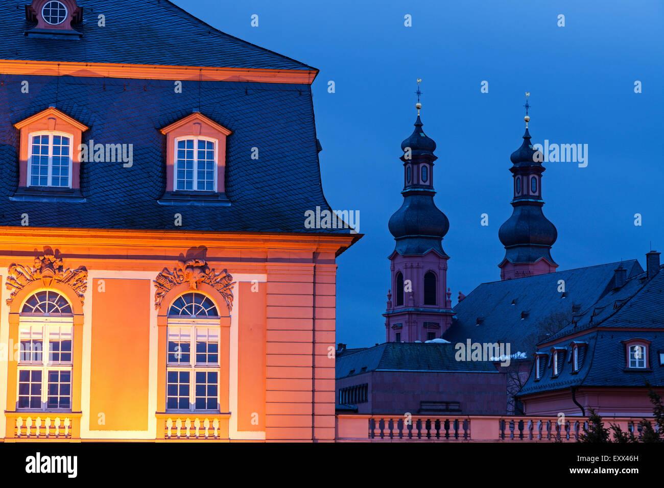 Illuminated Staatskanzlei Rheinland-Pfalz and St. Peter Church - Stock Image