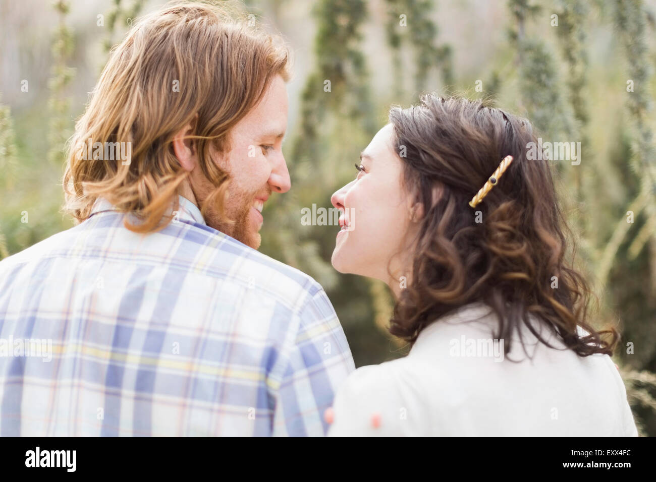 Smiling couple looking at each other - Stock Image