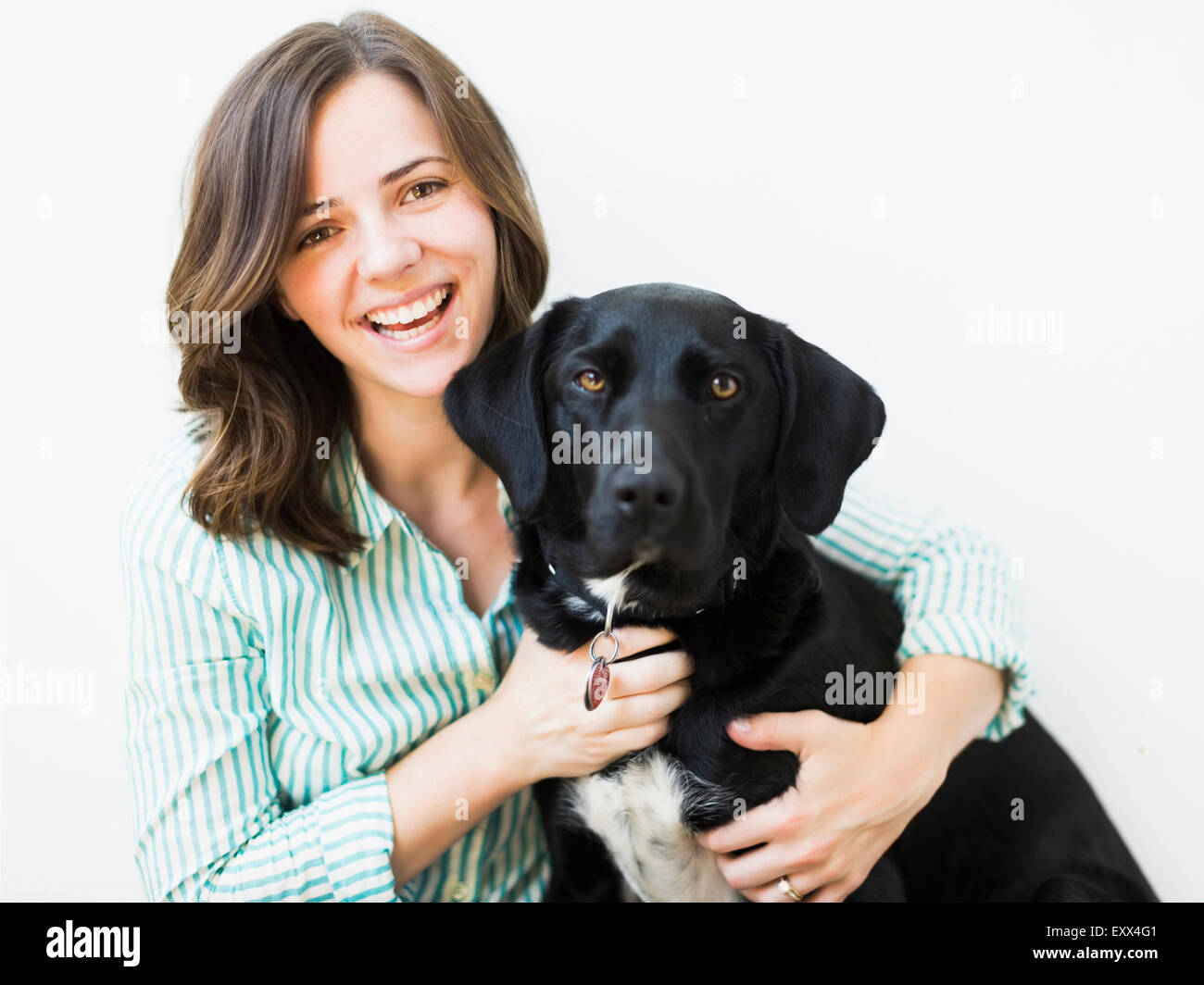 Portrait of smiling woman with dog - Stock Image