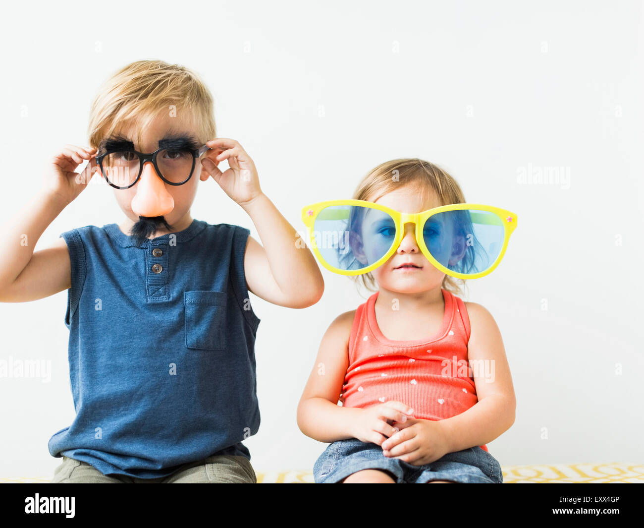Children (2-3) wearing novelty glasses - Stock Image
