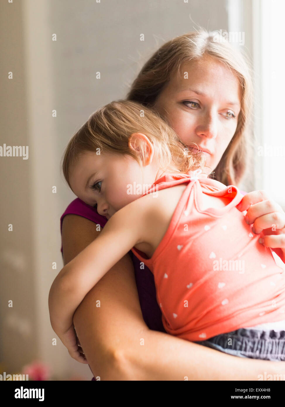 Mather carrying daughter (2-3) - Stock Image