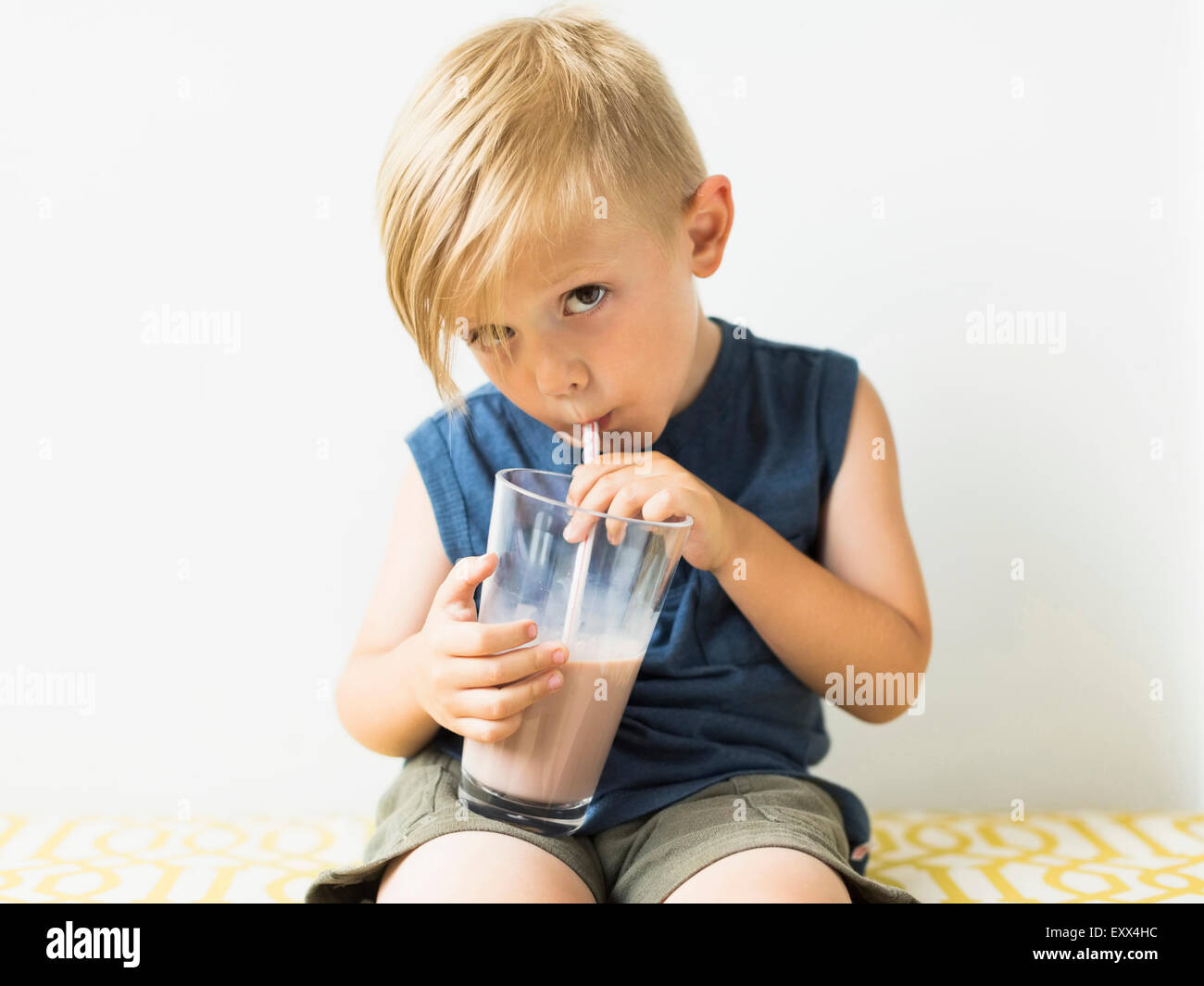 Young boy (2-3) drinking milkshake - Stock Image