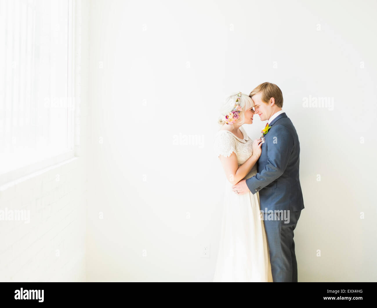 Newlywed couple embracing - Stock Image