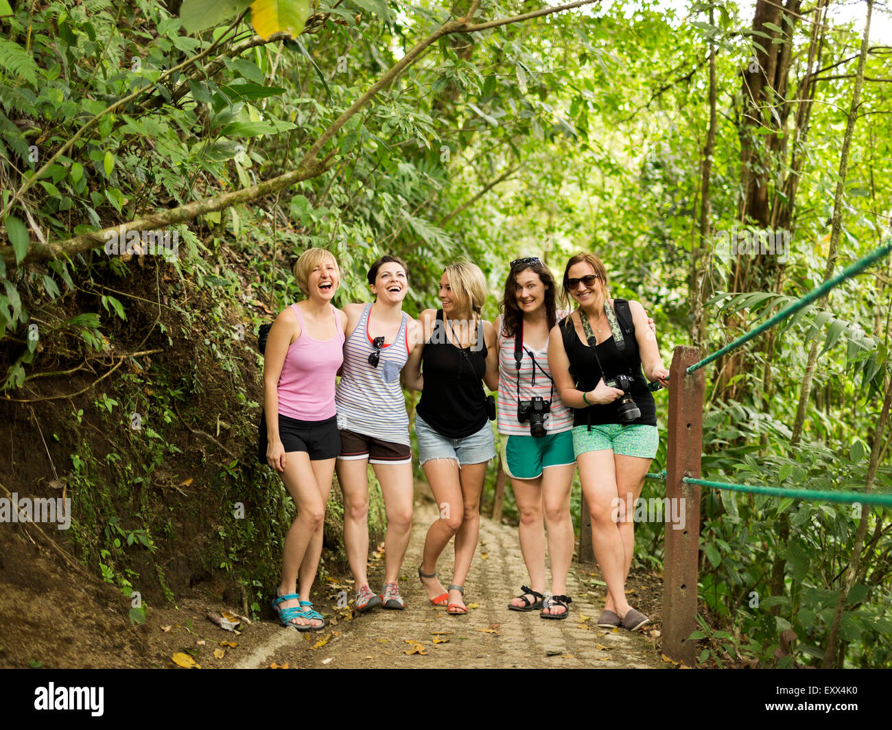 Young women on footpath in forest - Stock Image