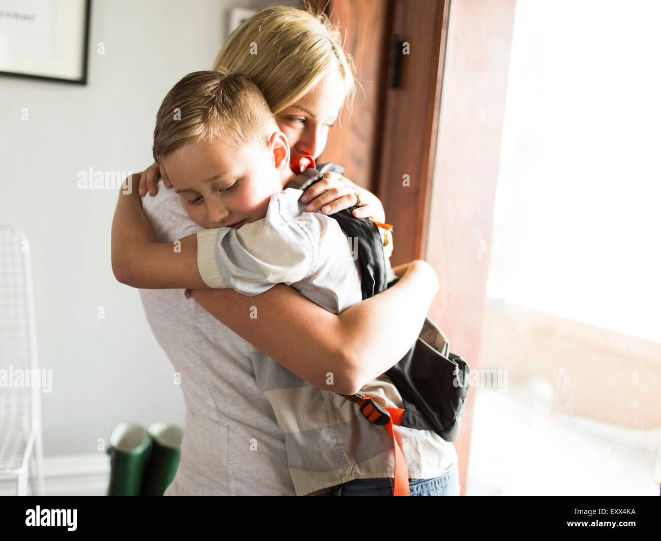 Mother hugging son (6-7) - Stock Image