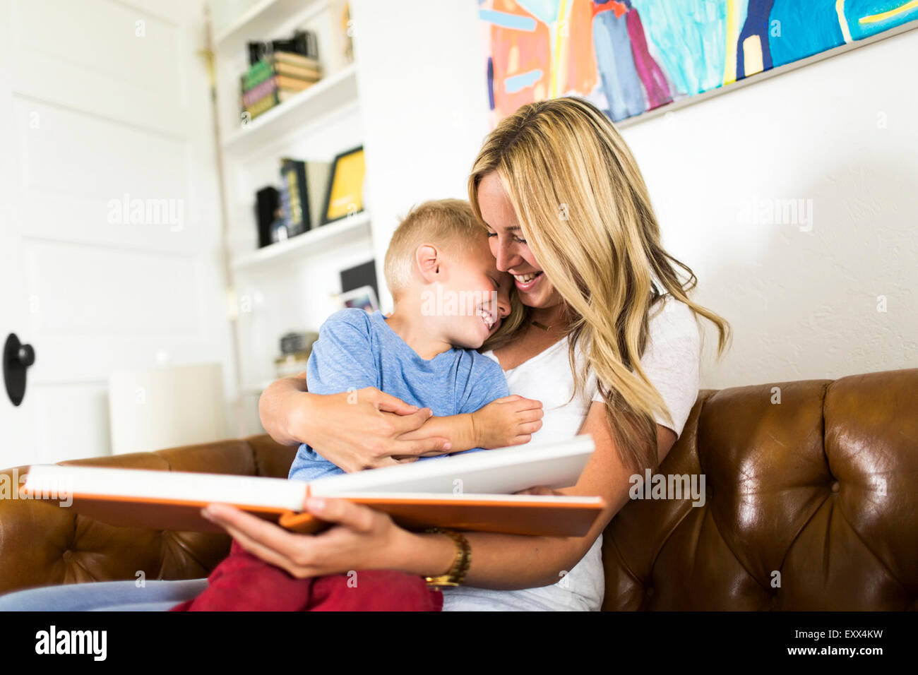 Mother reading book to son (4-5) Stock Photo