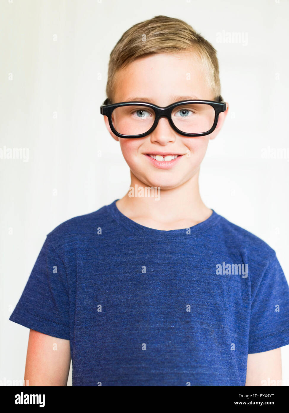 Portrait of boy (6-7) wearing eyeglasses - Stock Image