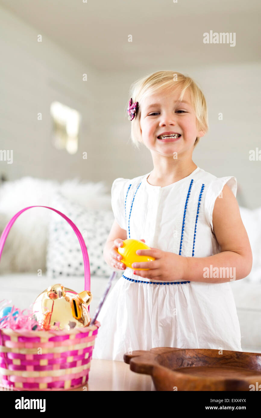 Portrait of girl (2-3) holding candy - Stock Image