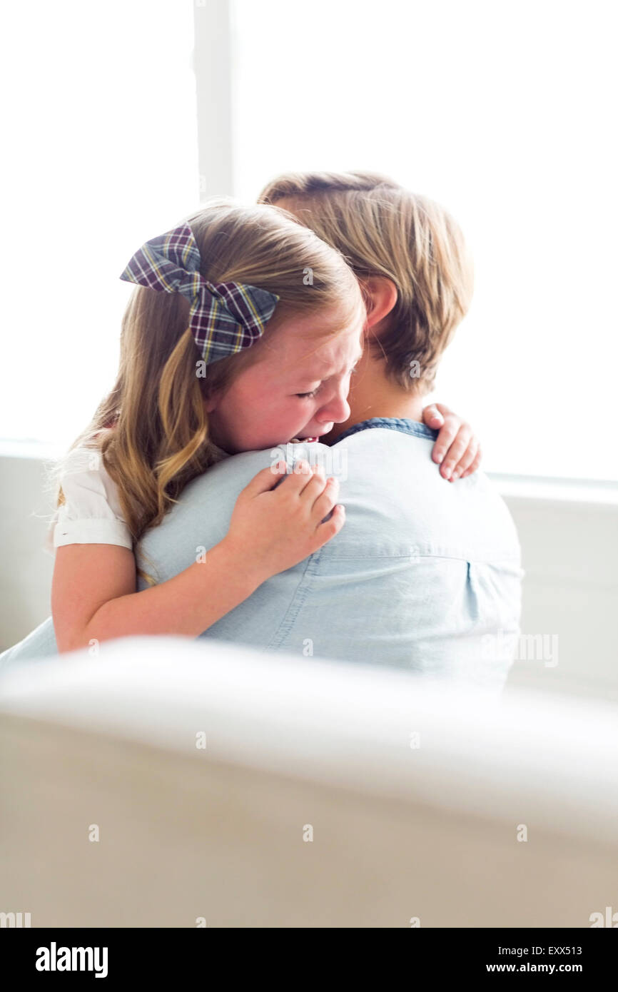 Woman consoling her child (4-5) - Stock Image