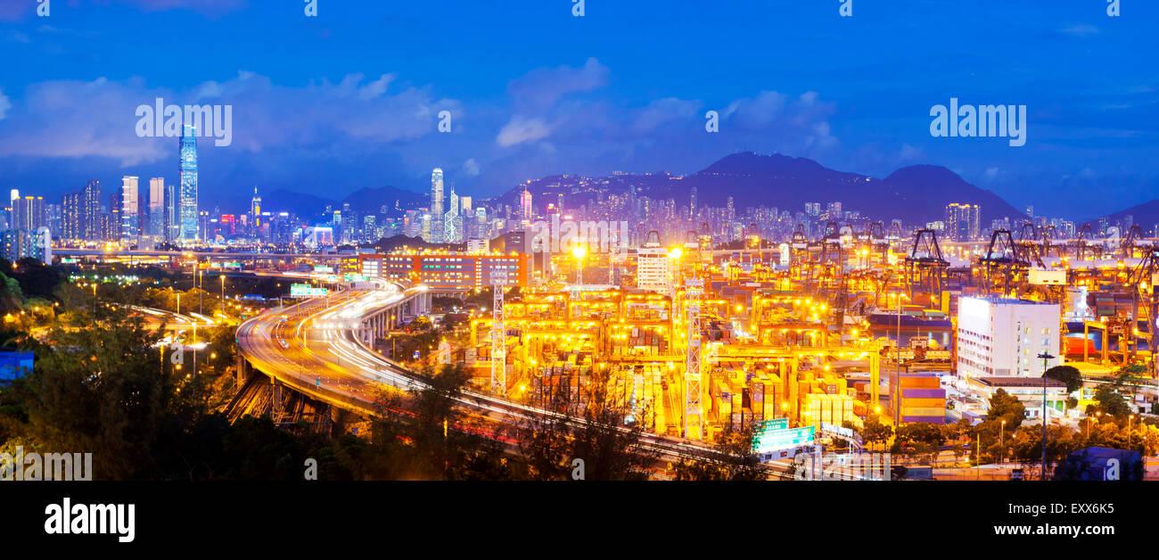 Panorama of cargo terminal and Hong Kong cityscape - Stock Image