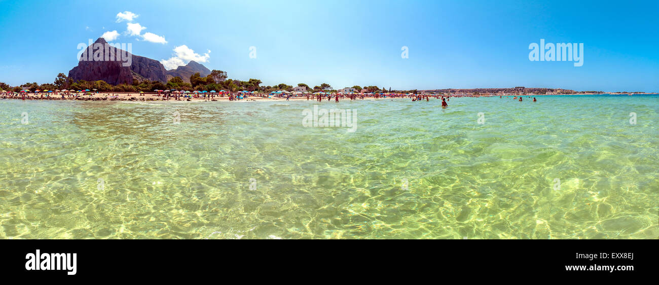 tourists and locals enjoy blue mediterranean sea in San Vito Lo Capo, Italy. - Stock Image