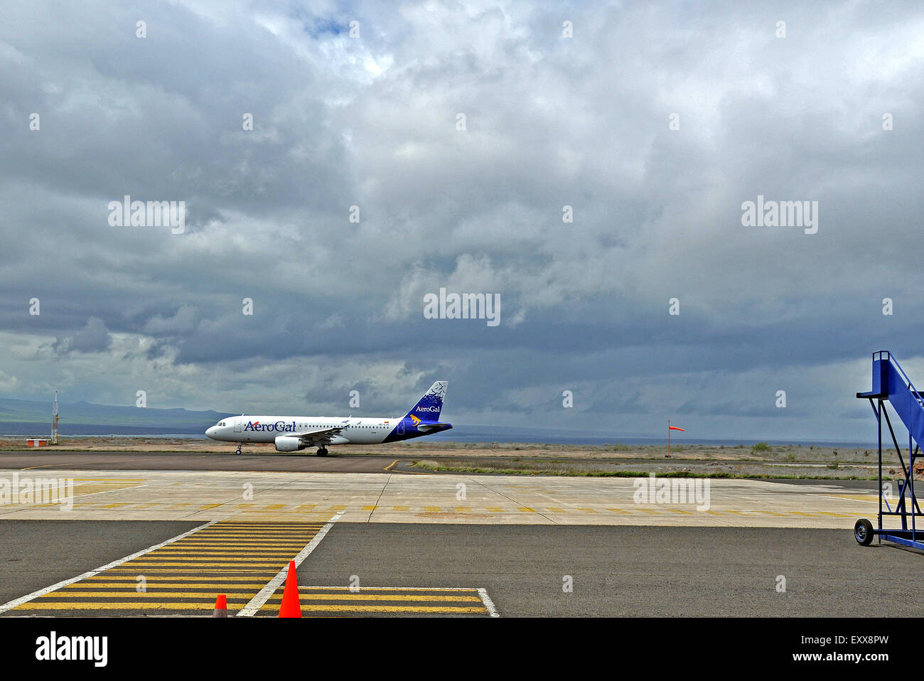 Airbus A320-200 of AeroGal airlines landing, Baltra airport, Seymour island, Galapagos, Ecuador - Stock Image