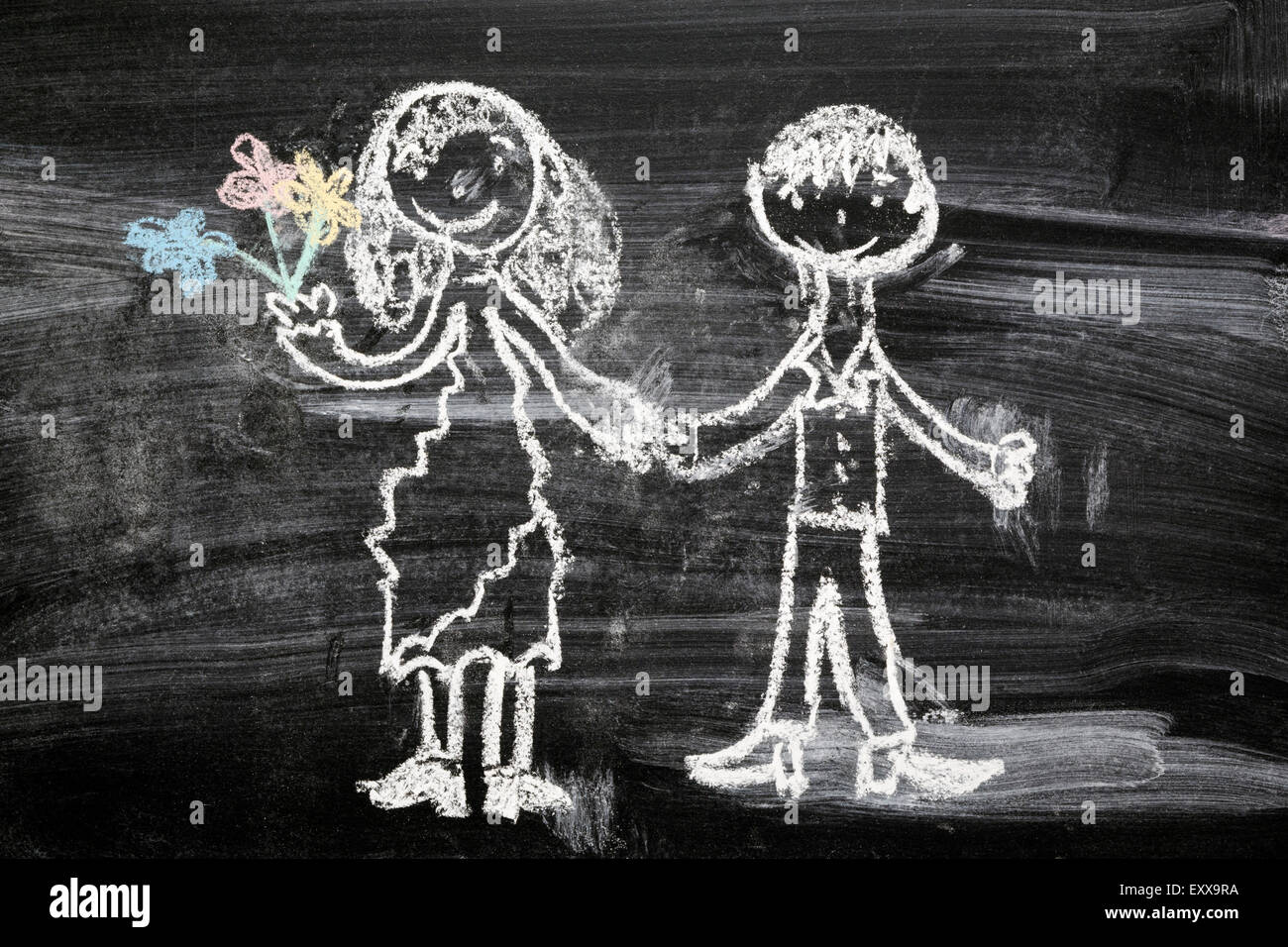 simple children chalk drawing of happy couple - Stock Image